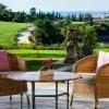 Hotel Villa Padierna, Marbella. La terraza de La Loggia, con maravillosas vista al Lago de Los Flamingos Golf Club