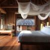 Six Senses Ninh Van Bay. Dormitorio de una Water Villa. Fotografía por Herbert Ypma