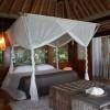 North Island Seychelles. Dormitorio principal de una villa. Fotografía por Simon Upton
